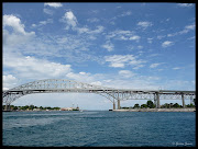 Sarnia, Ontario is to the left of the picture where a water tower can be . (bluewaterbridge)
