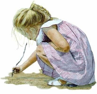 girl writing in sand