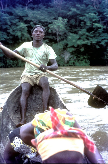 boatman crossing the River Moa in rainseason