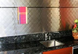 custom range hoods quilted stainless steel backsplash