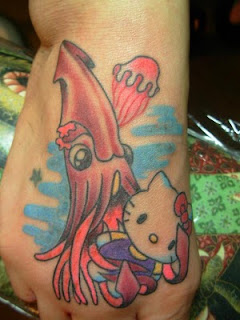 Hello Kitty squid tattoo on foot