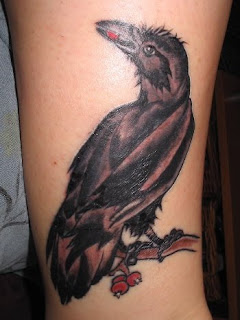 crow tattoo on hand