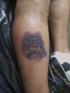 Gorilla portrait tattoo on hand