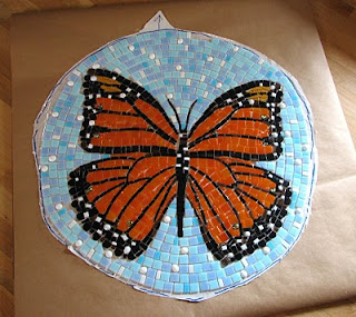 mosaic road        monarch butterfly on mesh