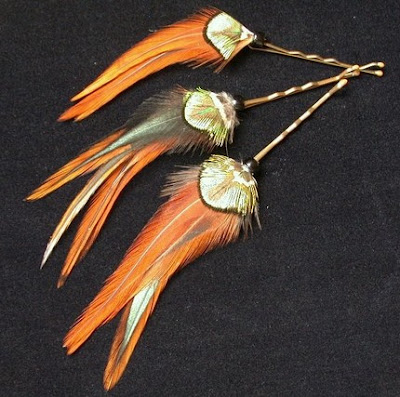hair with feathers. feather hair pins, $14