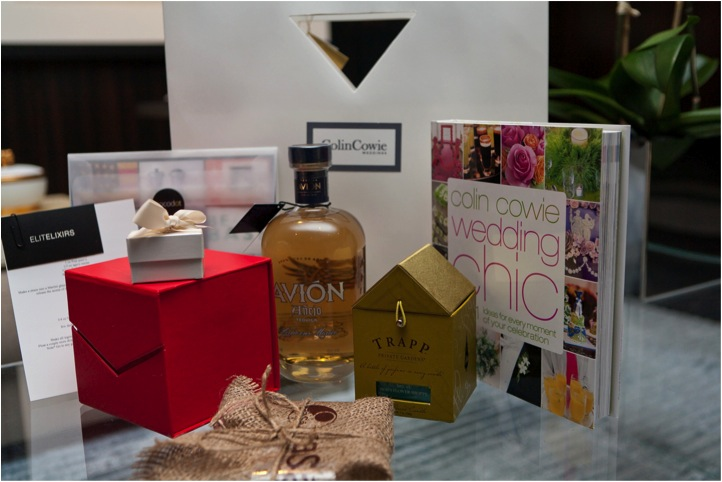 christmas party swag bag featuring trapp candles and avion tequila