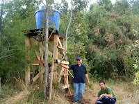 Chayito laughs as the final connections are placed between the tower and the cabin