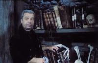 Vladimír Mensík as the janitor