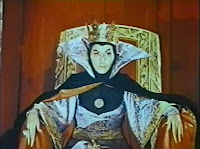Ofelia Guilmáin as the Queen of Badness