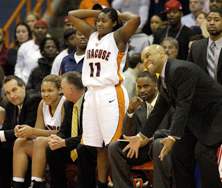 Syracuse women's basketball coach Quentin Hillsman reacts to a missed shot against UConn
