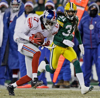 Plaxico Burress had 11 catches for 154 yards