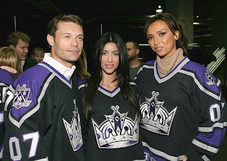 Ryan Seacrest, Kim Kardashian and Giuliani DePandi at a Kings game.  I guess no one told Kardashian that black guys don't play hockey.