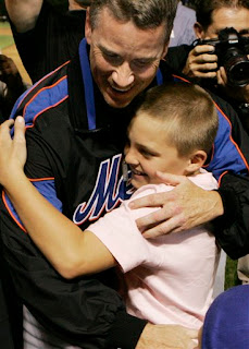 Tom Glavine hugs his son after the game
