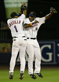 Castillo and Milledge celebrate the Mets comeback victory over the Braves on August 8th