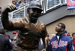 Kirby Puckett Jr stands by the statue of his father at Target Field
