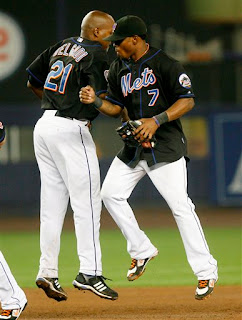 Jose Reyes and Carlos Delgado celebrate a big win over the Phillies