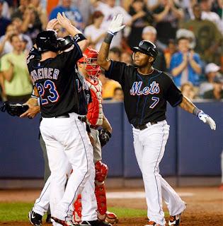 Jose Reyes celebrates his game winning 3-run homer
