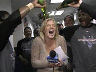 a picture from the famous drenching Julie Donaldson received from the Mets after they clinched the division in 2006