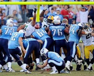 Rob Bironas kicks the game-winning field to keep the Titans perfect