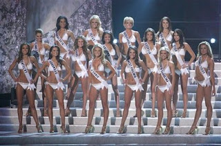While other pageant contestants hide their flat chests with their sashes Miss California shows off her bodacious tatas