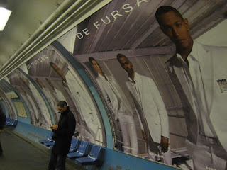 Paris subway with mens fashion advertisement