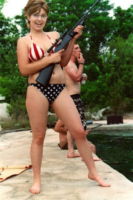 Sarah Palin looks hot in this bikini. But toting such a big gun, it's a good thing she's smiling