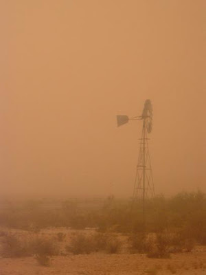 a windmill in a dust storm in New Mexico, July 2004
