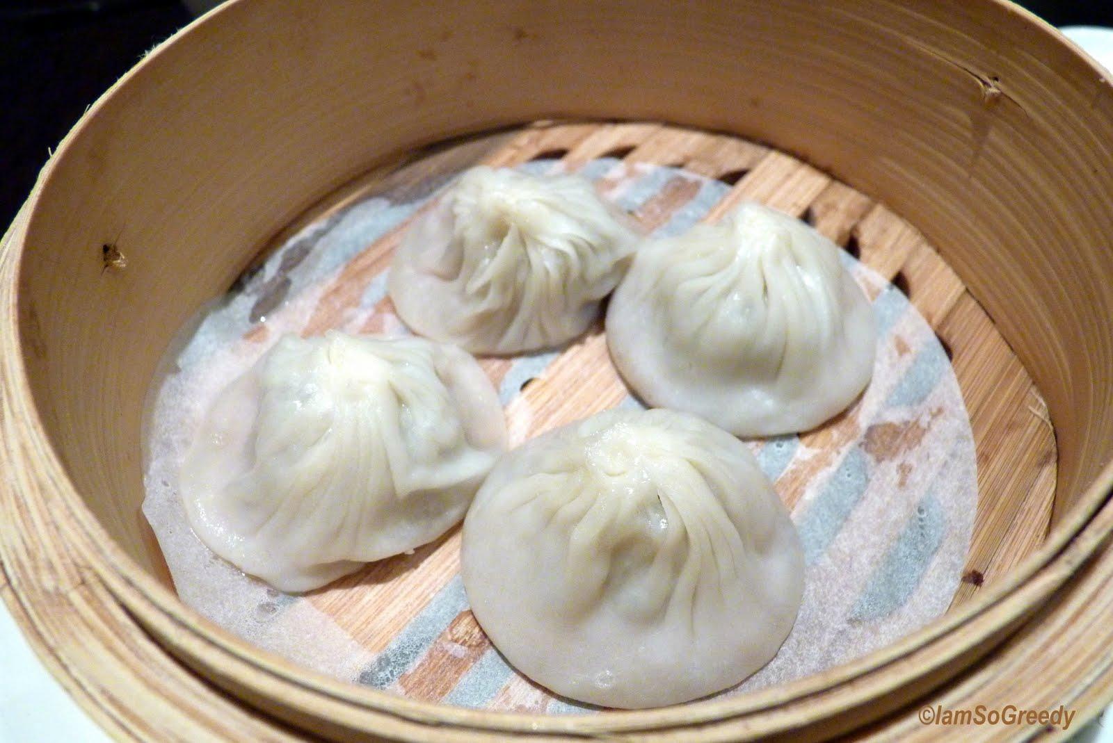 xiao long bao the xiao long bao upon being lifted up by the chopsticks ...