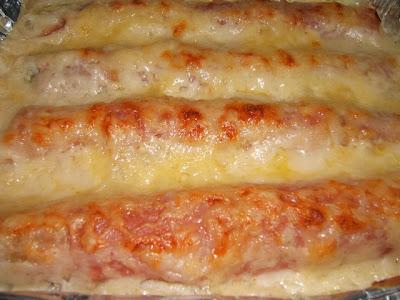 Puerros gratinados con jamón y queso