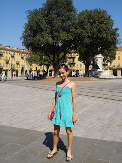 daughter standing in the newly restored Place Garibaldi