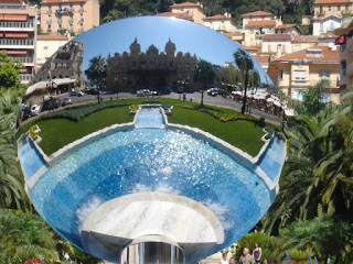 Monte Carlo Casino reflected in a mirror sculpture in the gardens in Place du Casino