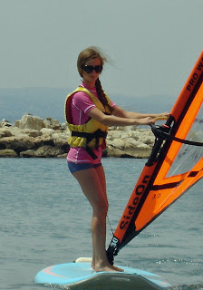 daughter during a wind surfing lesson, July 2009