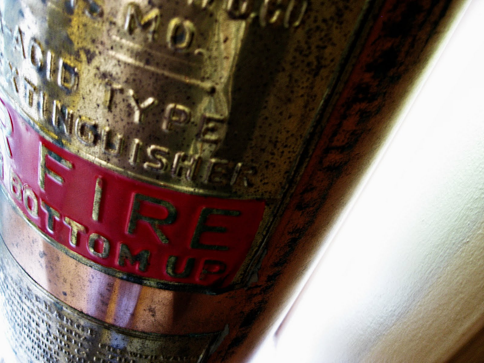 close-up of a brass fire extinguisher