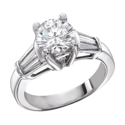 Note This simple diamond engagement ring has five prong set round diamonds