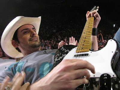 brad paisley and wife. rad paisley and wife kiss.