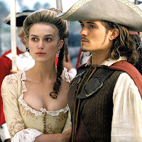 It takes more corset than that to give Keira cleavage and probably a less silly hat to make Orlando look butch.