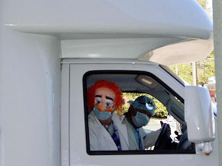 Puppy Truck drivers Lee and Joe pictured in the cab of the truck in their Halloween costumes