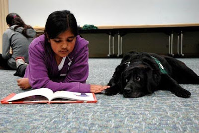Filene with a child at the Read to the Dogs program