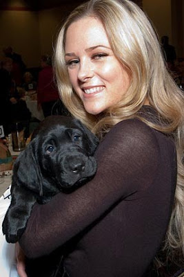 A puppy raiser and her new pup at the Oregon Fall Luncheon
