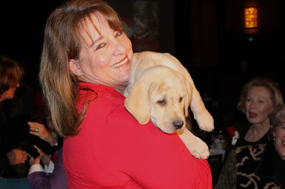 Puppy raiser Ellen Aguirre with yellow Lab Addison