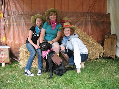 Brenda, Kate, and Maddie Hall with black Lab Christina