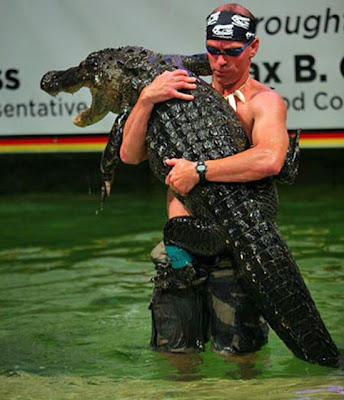man wrestling alligator