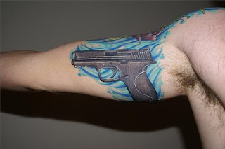 Zoom tattoos gun tattoos for Gun holster tattoo