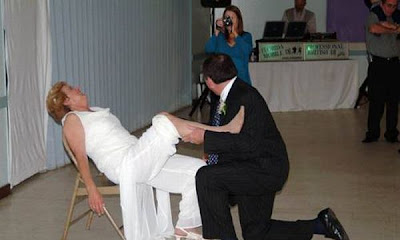 Funny Wedding Songs on Funny Garter Removal Pictures   Wedding Songs   Zimbio