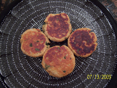 Cooked Potatoes Chopped Formed Into Cakes And Pan Fried
