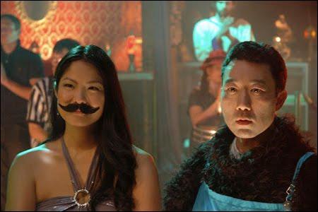 Hiroshi Watanabe mulls over getting a mustache ride from Lynn Chen.