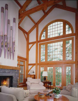 timber frame great room with wall of windows