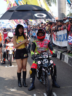 hot umbrella girl with her racer