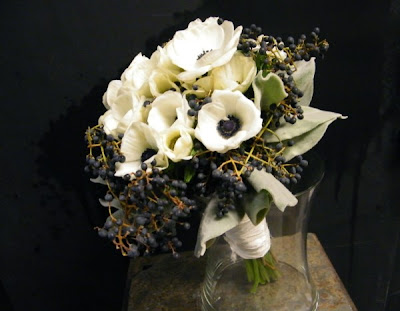 This allwhite winter wedding bouquet was created with Dusty Miller greens