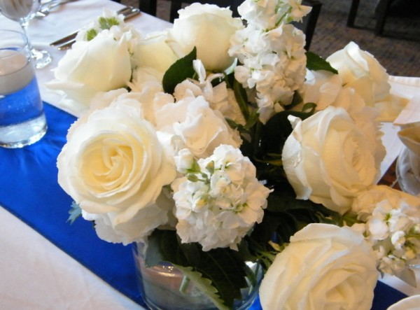 Table centerpieces were allwhite and filled with Roses and very fragrant